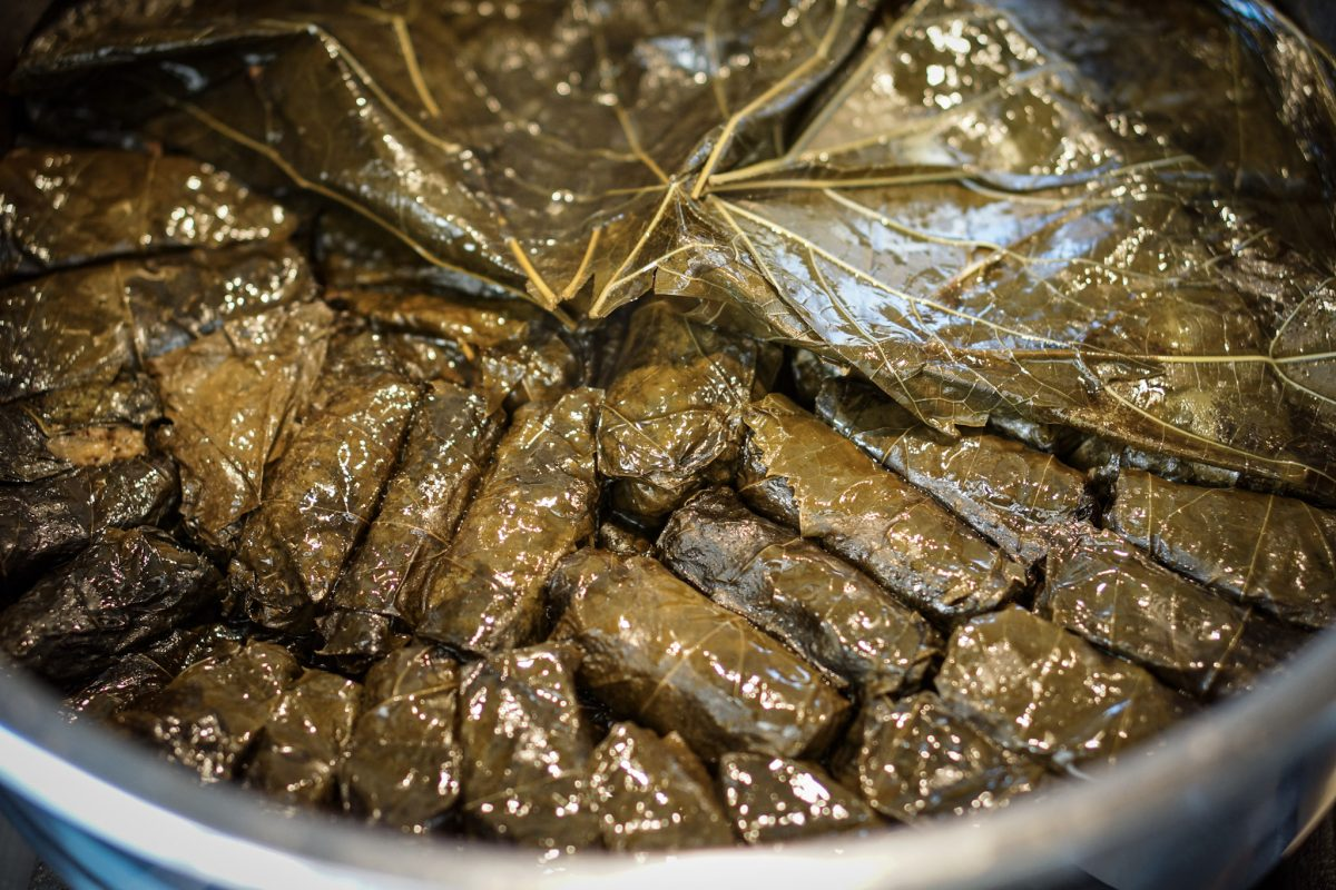 Mix the sauce ingredients together and pour over the prepared dolmeh.   Cover, and simmer gently for 2 hours.  Remove the pan from the heat and allow the dolmeh cool, before transferring to a serving platter or container of your choice.